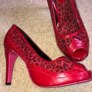 Red leopard pumps